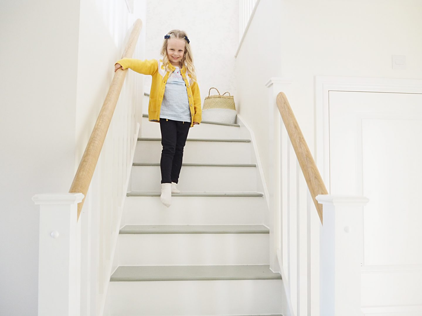 child walking down stairs