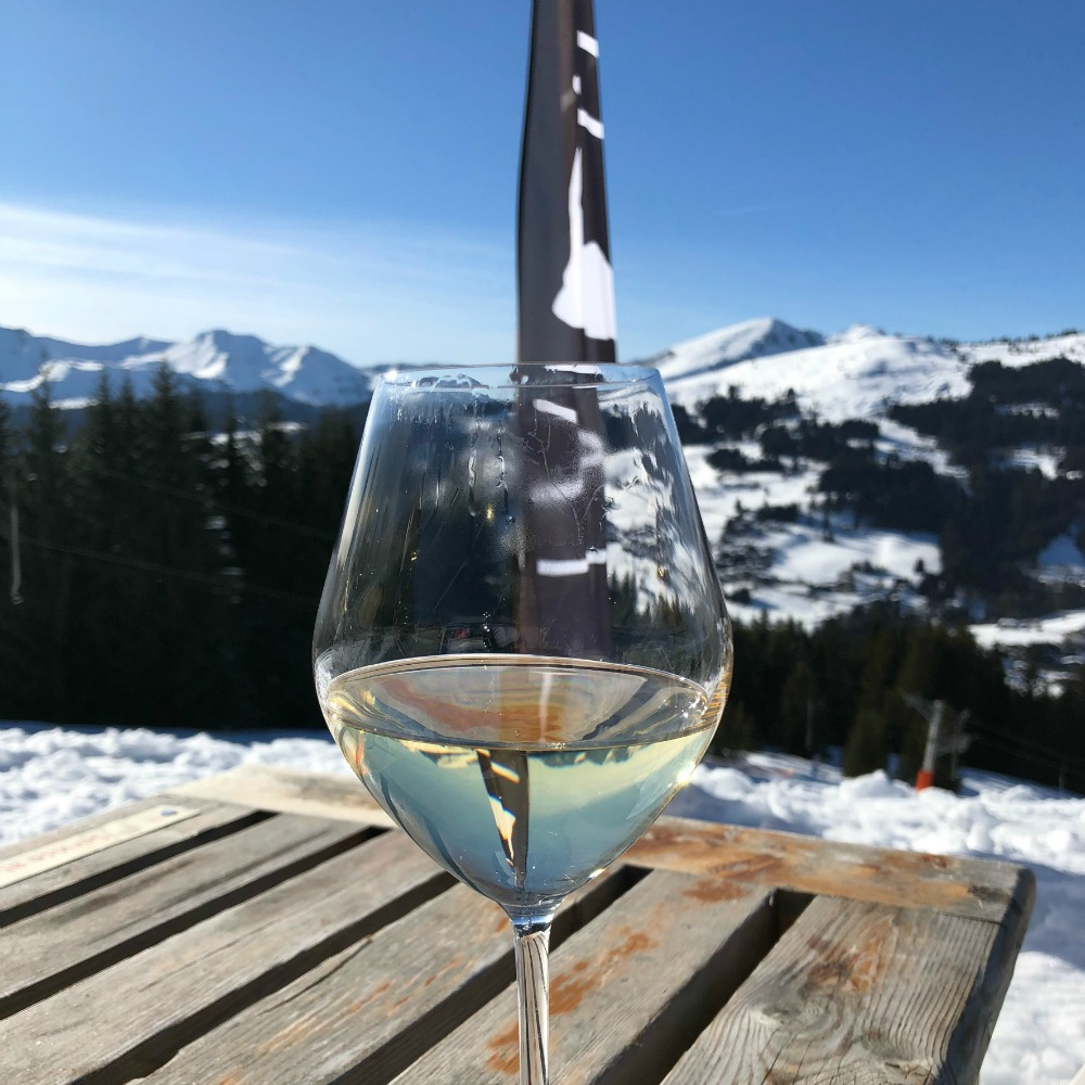 glass of wine on the ski slopes
