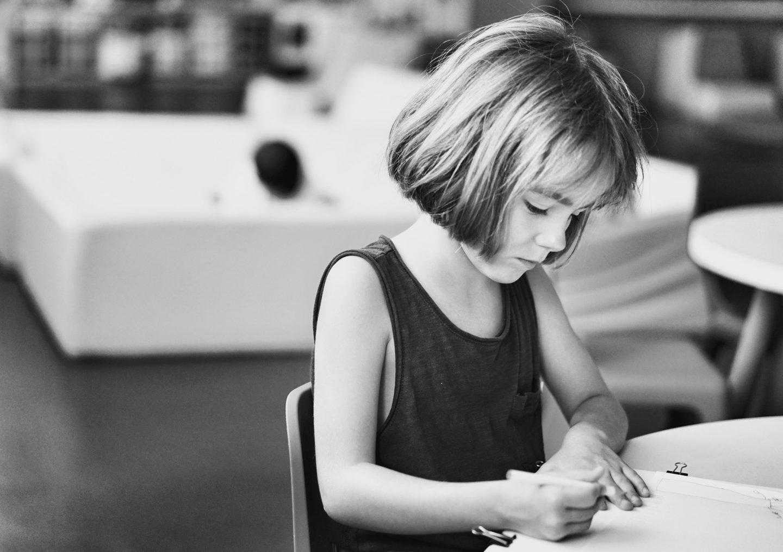 child writing a story