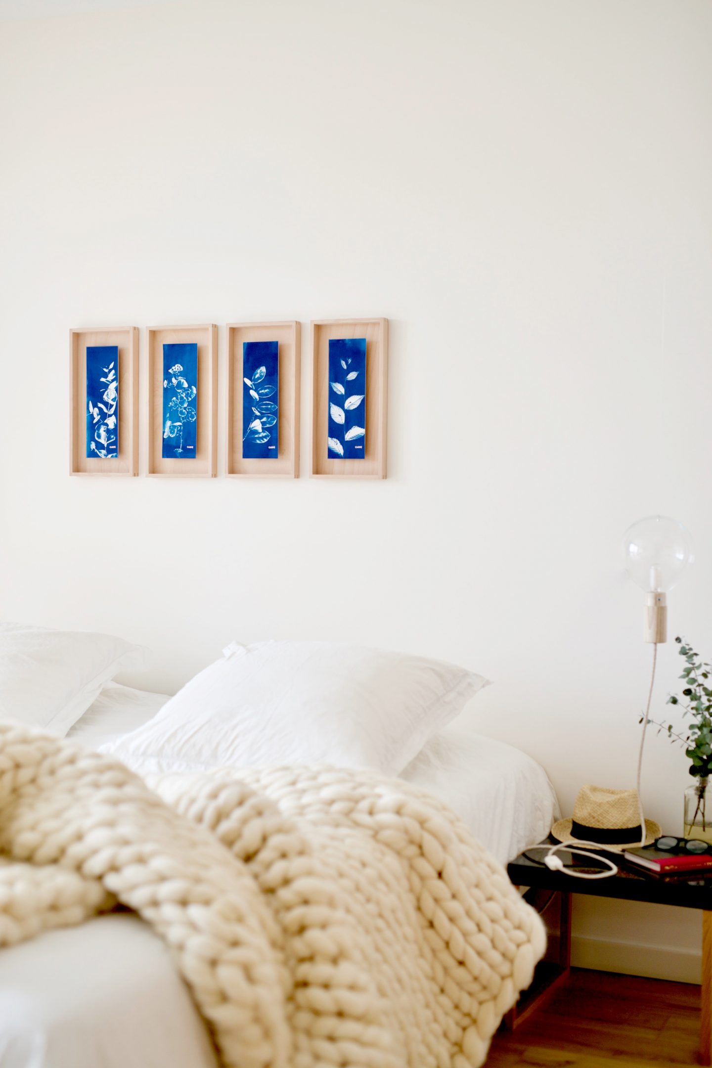 paintings above bed